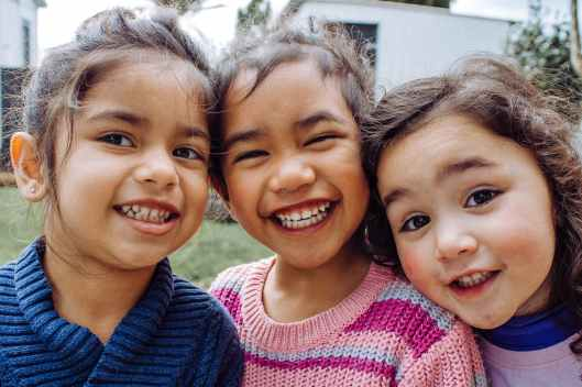 portrait photo of three smiling girls